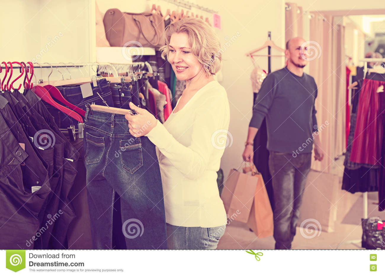 Woman buying jeans stock image  Image of european, choice - 81117083