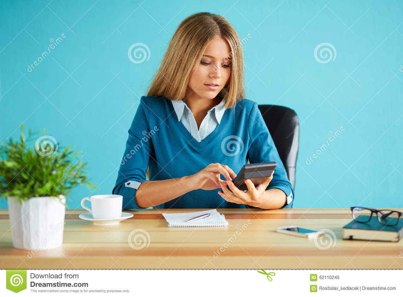 woman calculates tax stock photo