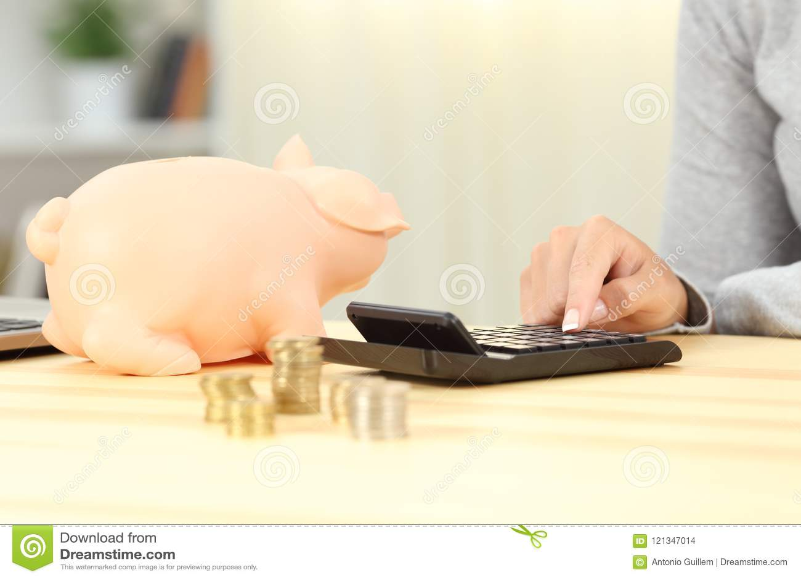 Woman calculating savings at home