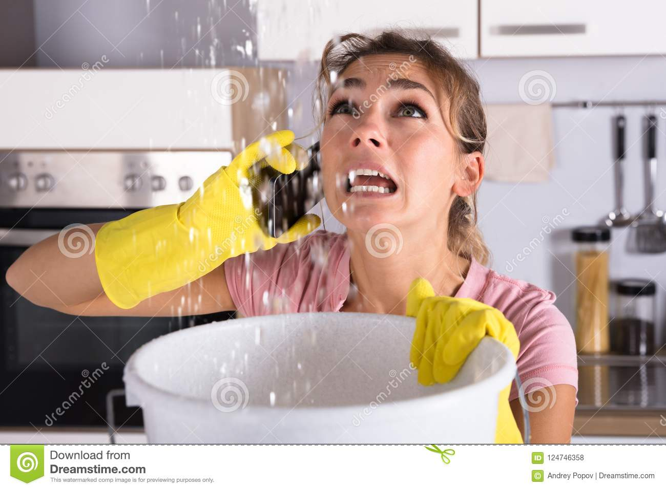 Woman Calling Plumber To Fix Water Leaking From Ceiling