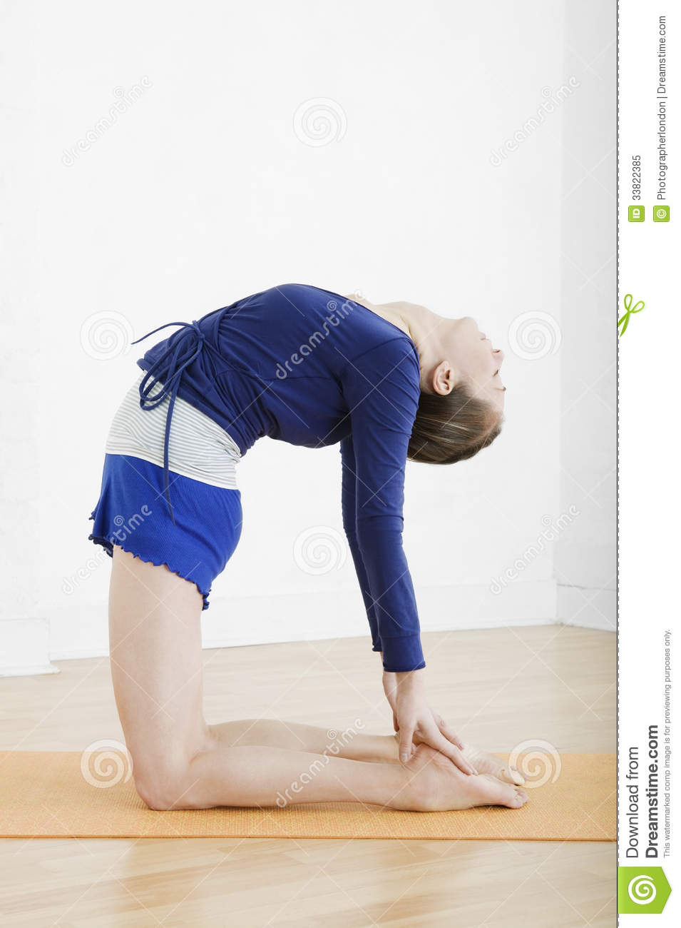 Woman In Camel Yoga Position At Gym Royalty Free Stock