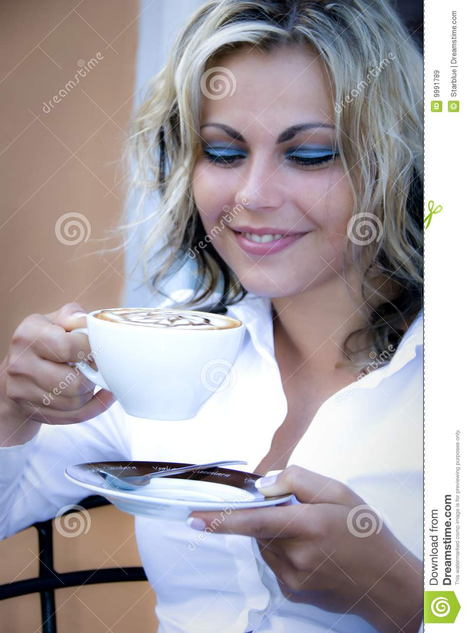 Woman with cappuccino coffee