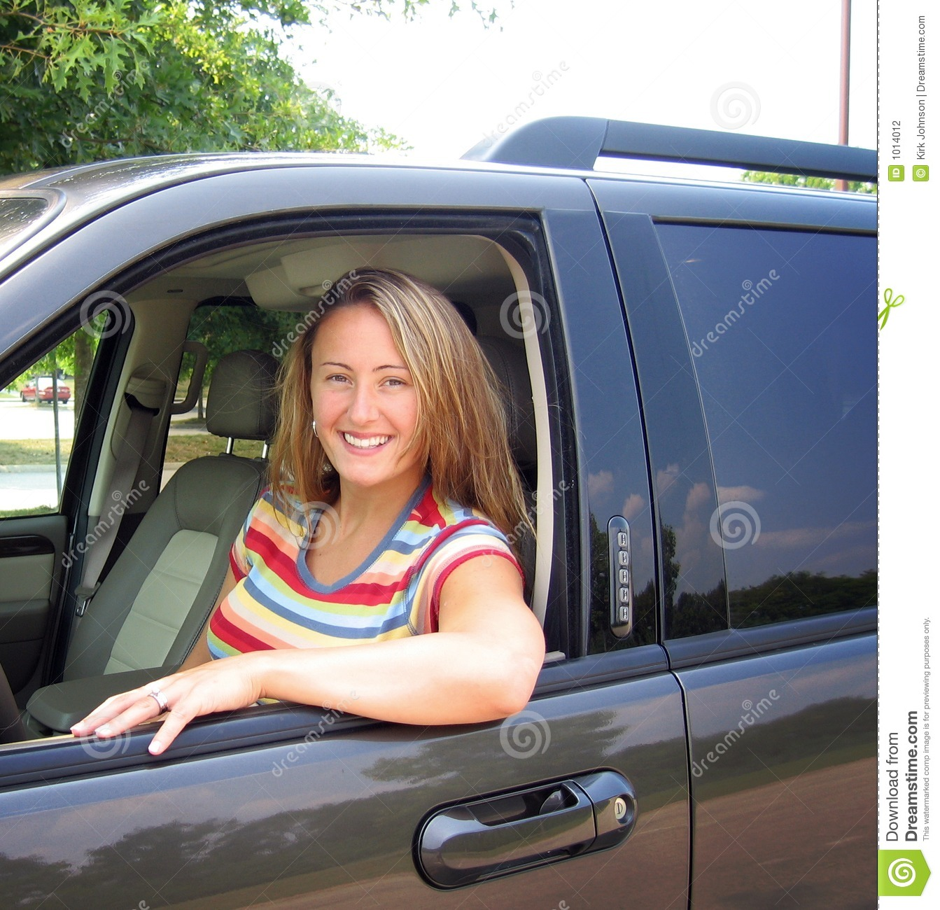 beautiful young woman driving a car, could be a soccer mom, or great ...