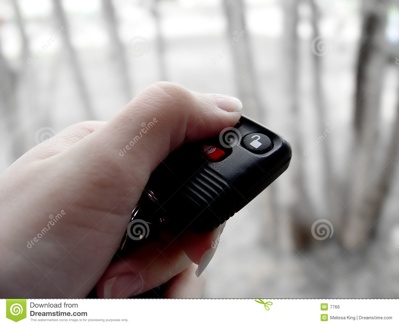 Woman with car lock remote