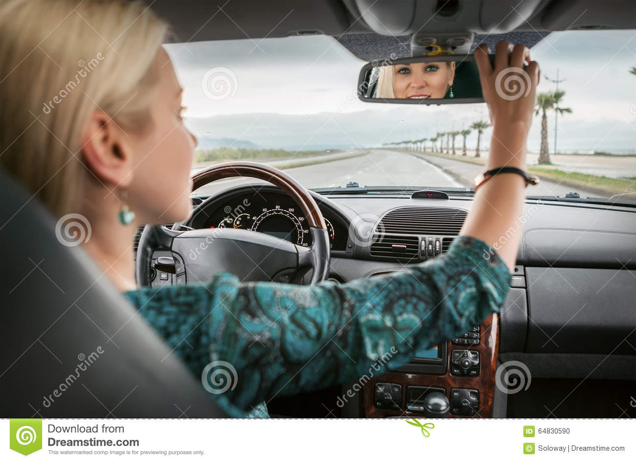 woman in car look in rear view mirror stock photo image of attractive automobile 64830590. Black Bedroom Furniture Sets. Home Design Ideas