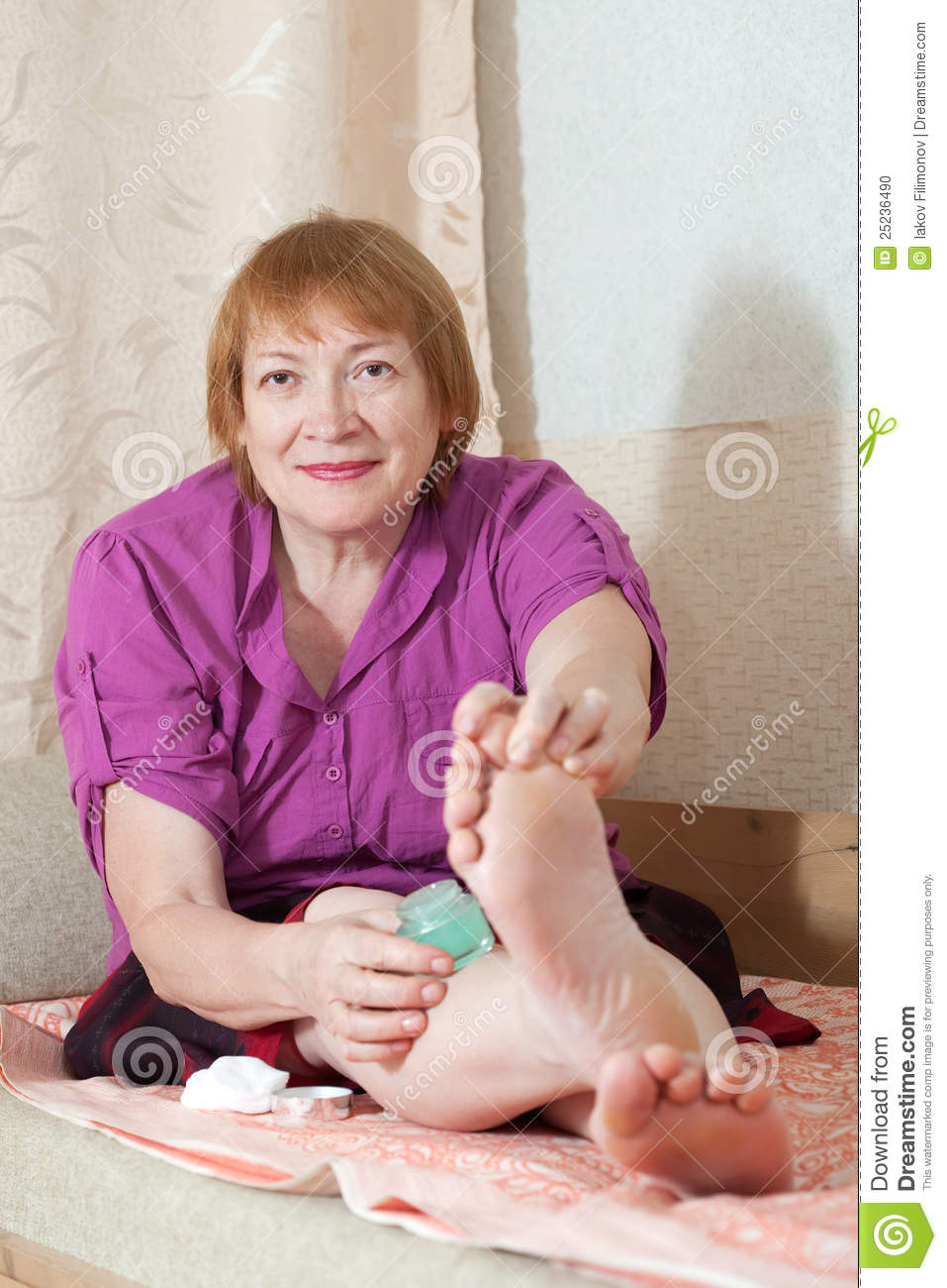 Woman Caring For The Nails On Your Feet Stock Photo