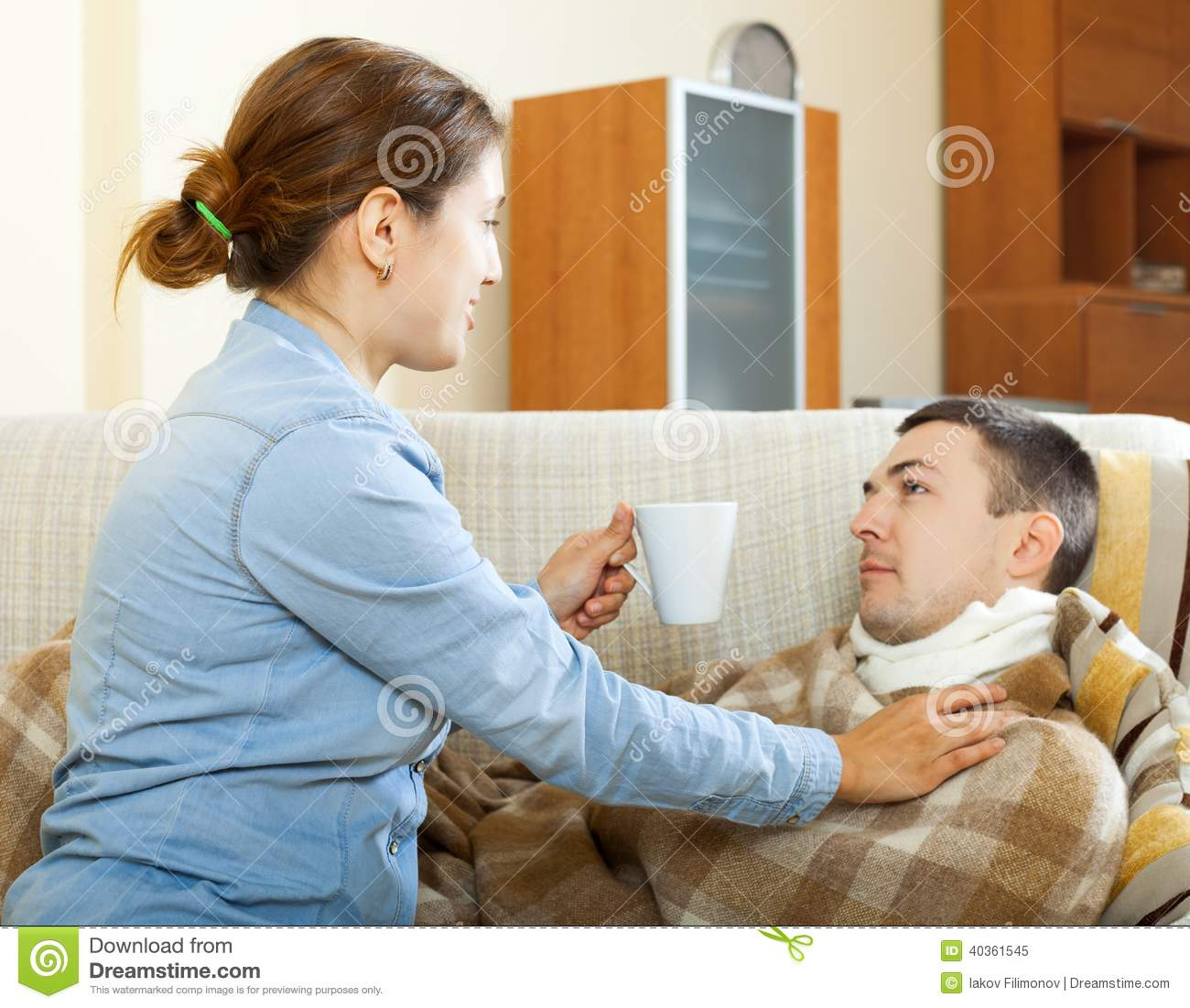 Woman Caring For Sick Husband Stock Image