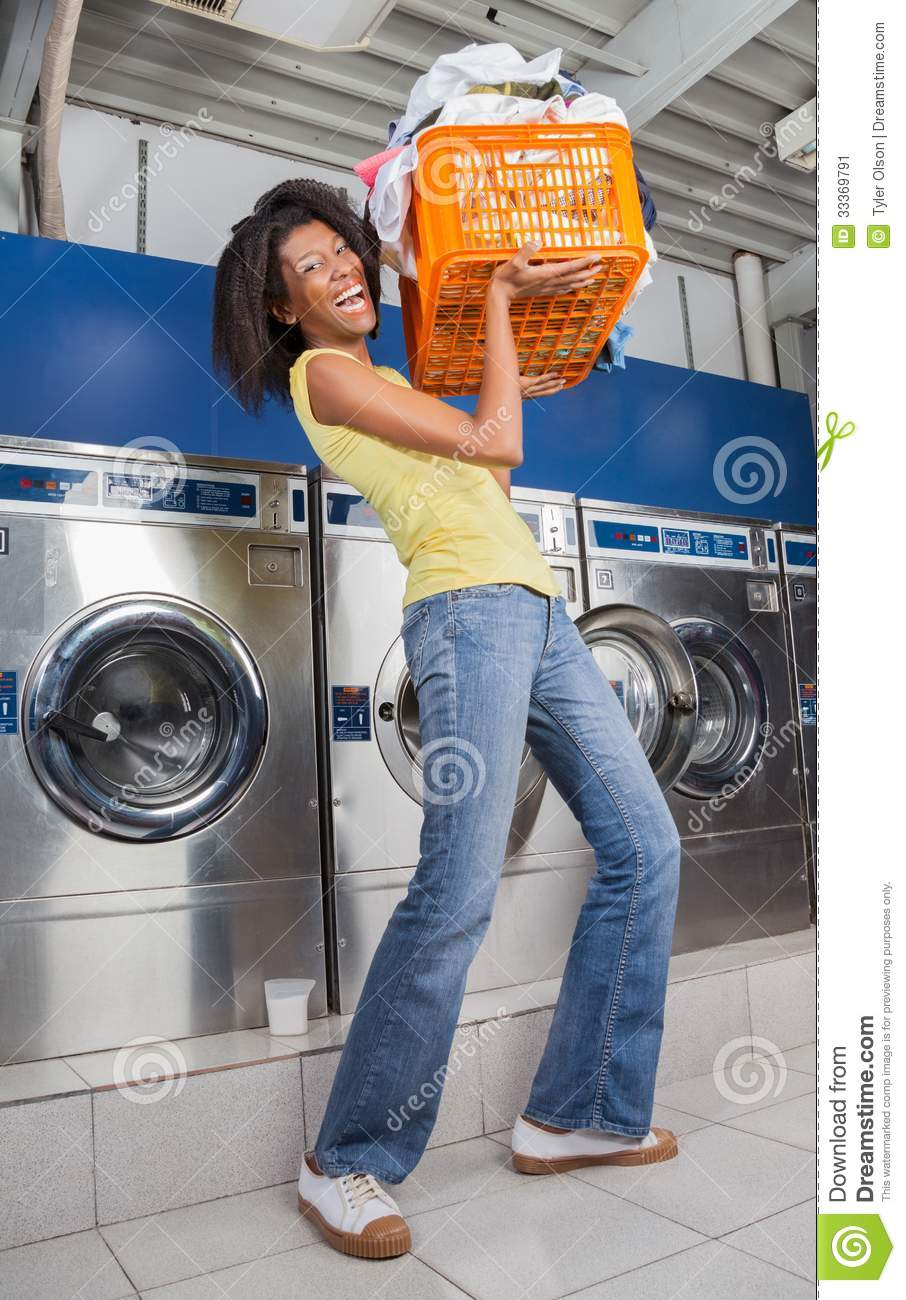 Woman Carrying Heavy Basket Of Clothes Stock Image Image