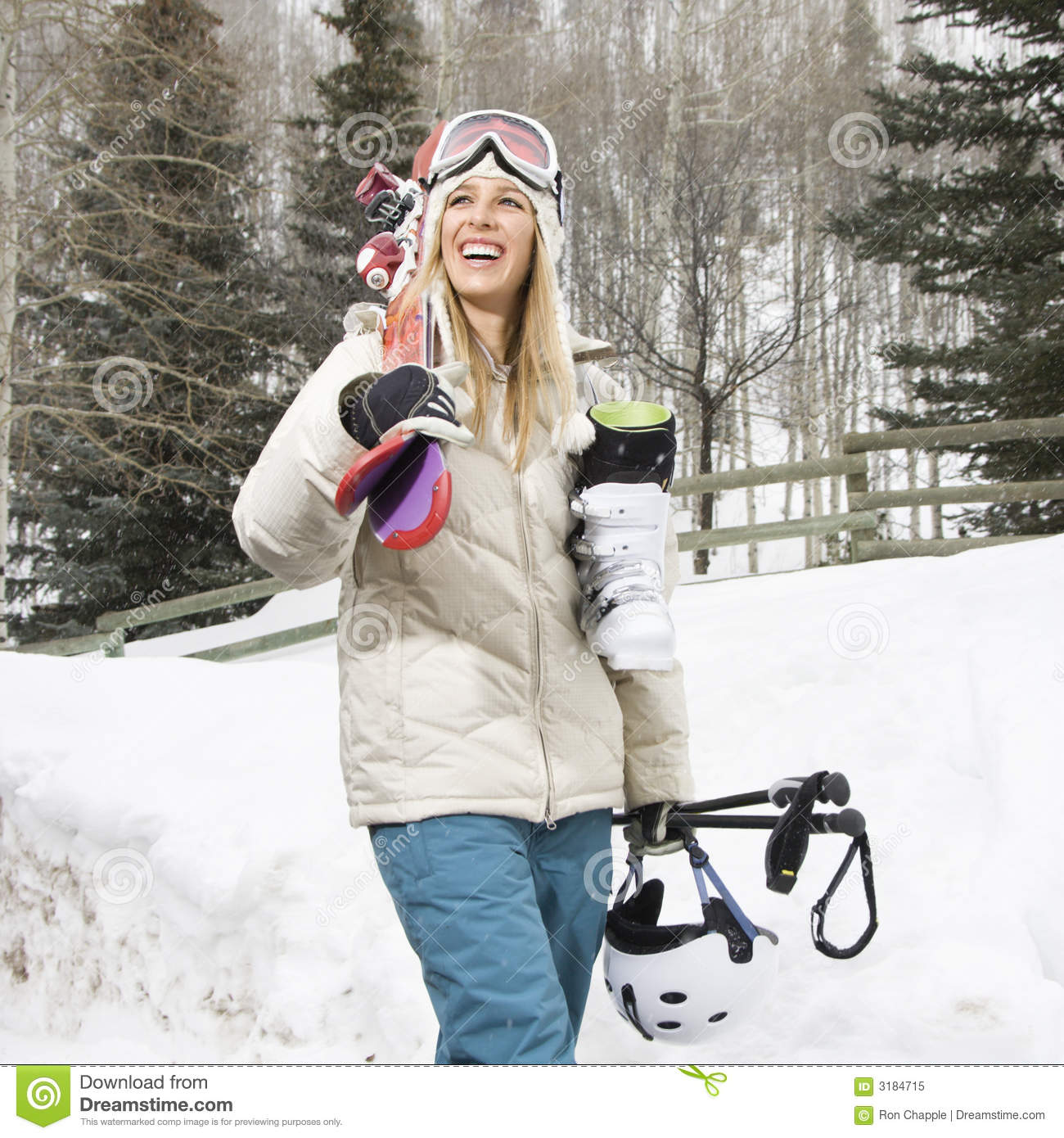 Woman carrying ski gear.
