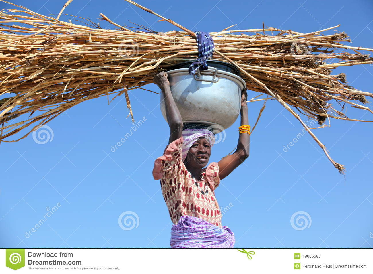 Woman carrying straw