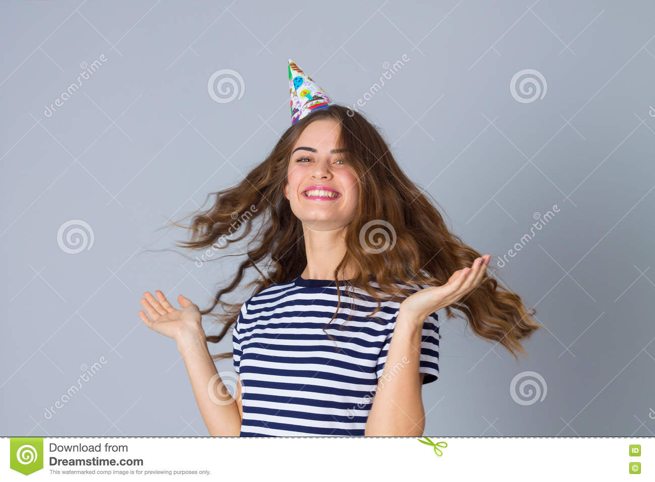 Woman in celebration cap whirling