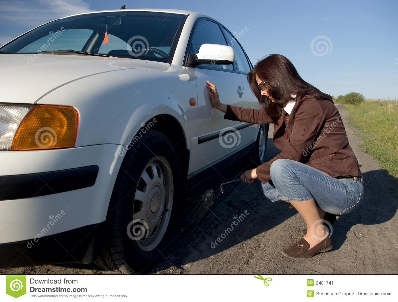 Woman changing tyre.