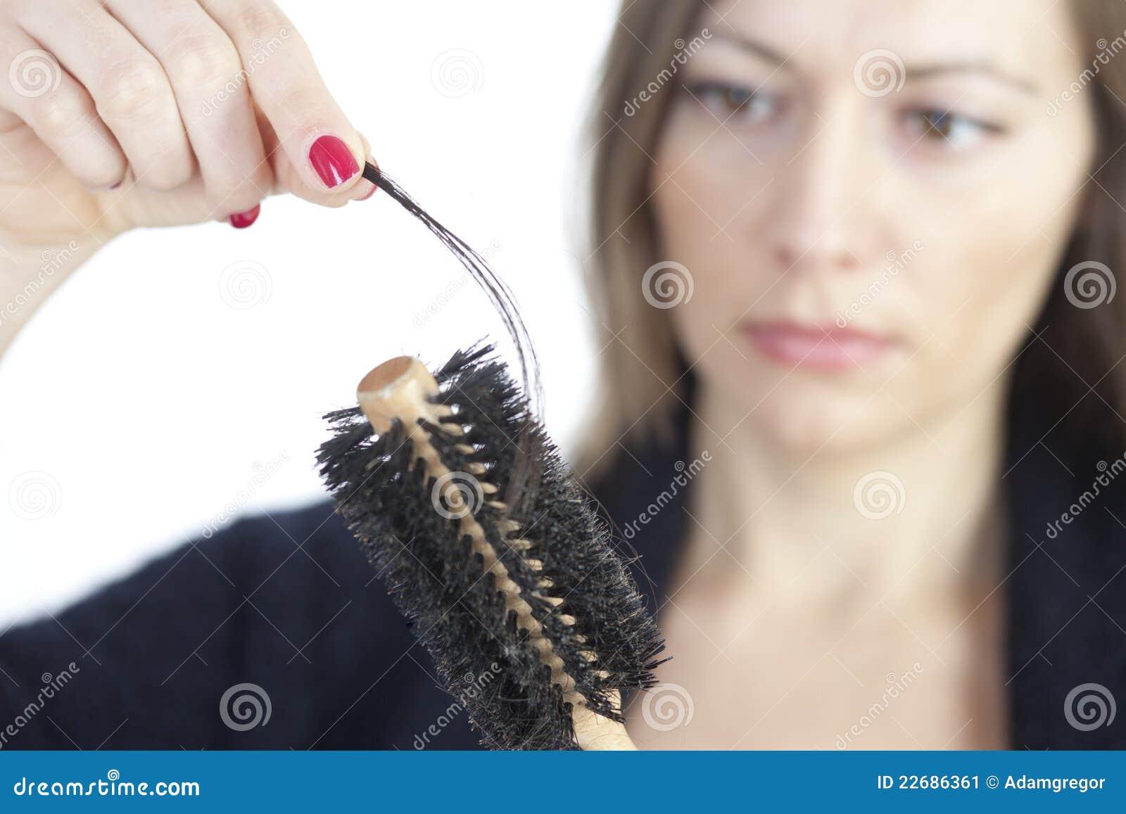 Woman checking if hair loss