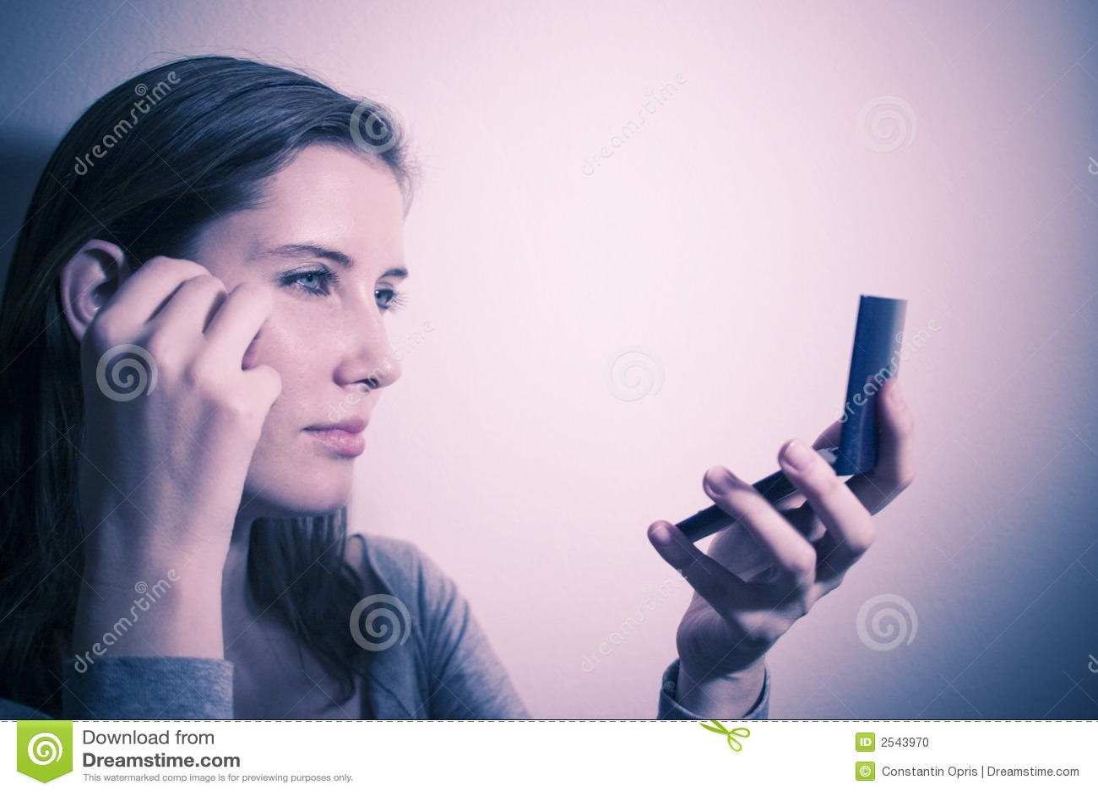Woman checking makeup