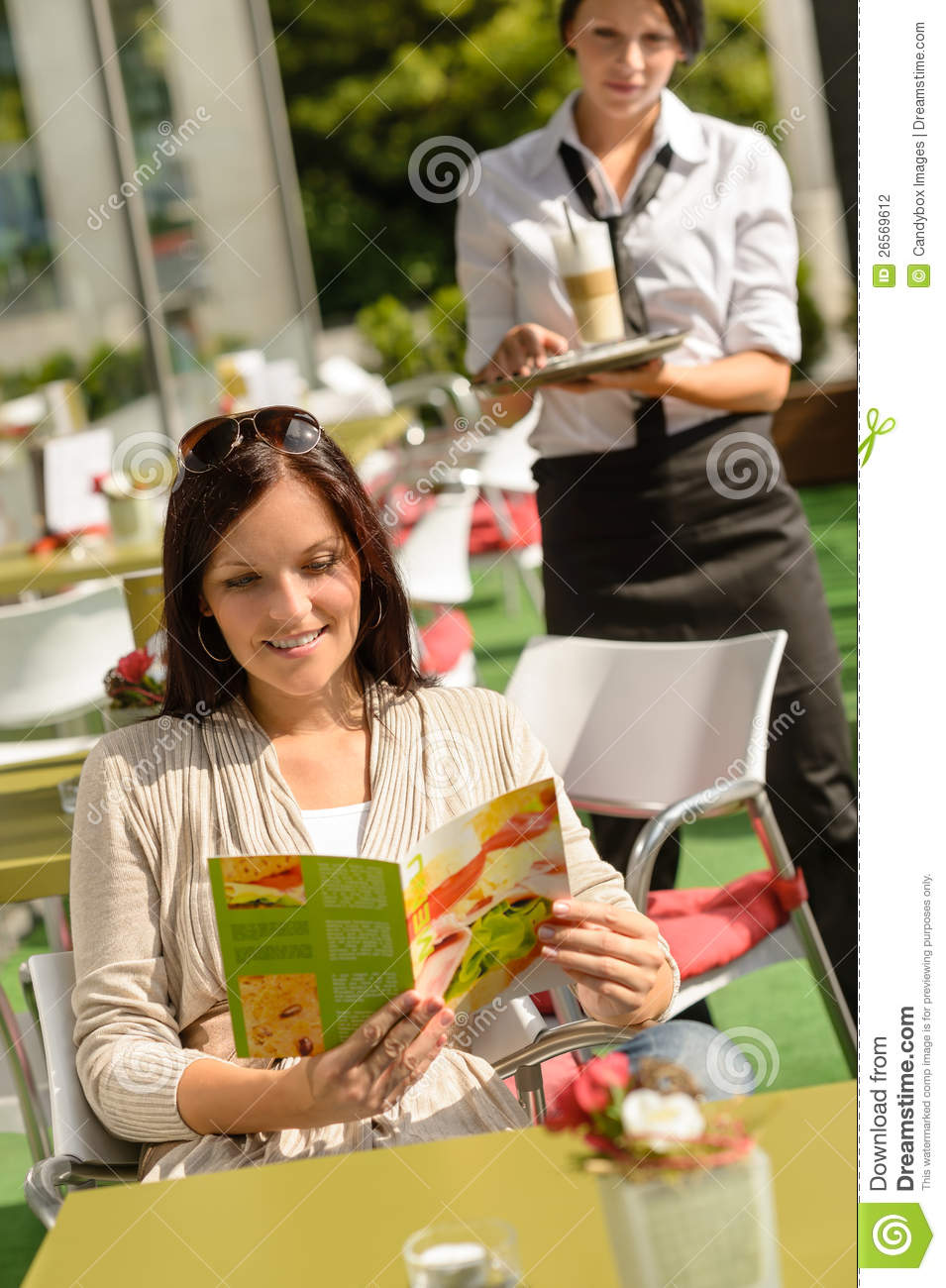 Woman checking menu waitress bringing order coffee