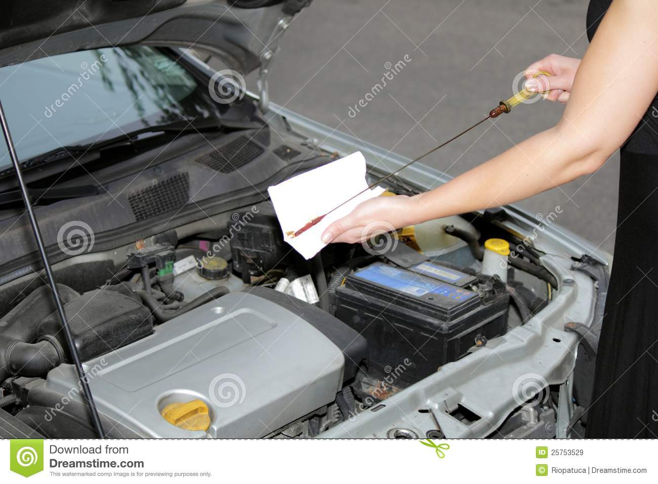 Woman Checking Oil Engine Level 2 Royalty Free Stock