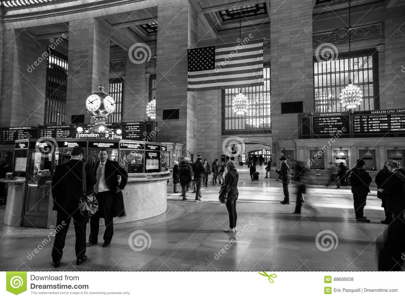 Woman Checking The Schedule Of Trains At Grand Central Station