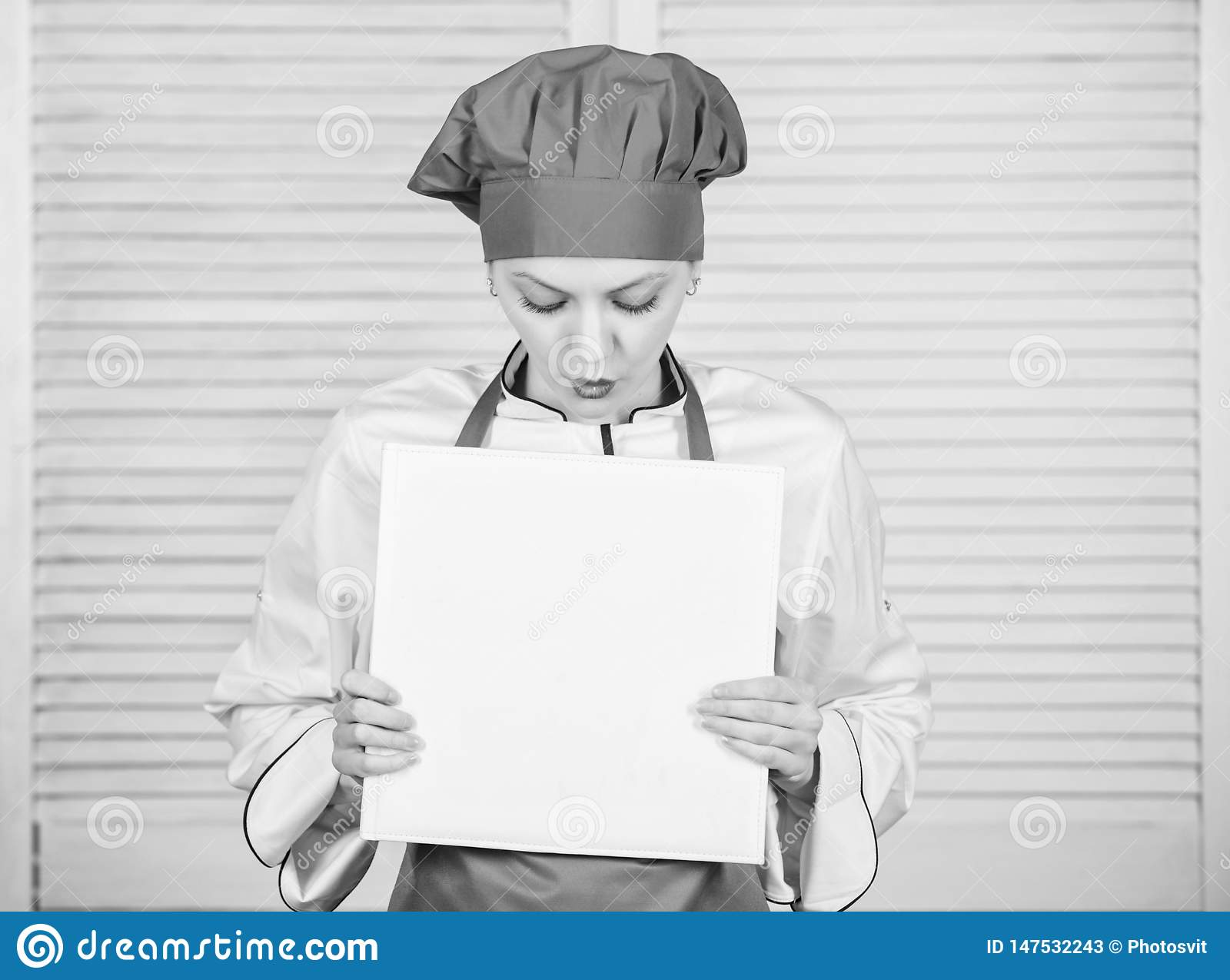 Woman chef cooking food. Culinary concept. Amateur cook read book recipes. Girl learn recipe. Book written by me. Book