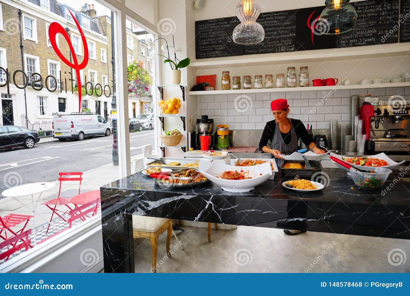 Female Restaurant worker prepares Healthy Dishes in Street View Kitchen