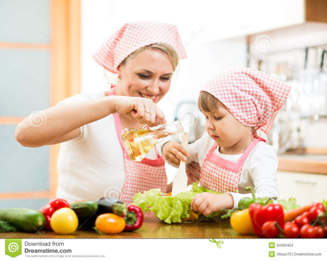 Woman And Child Preparing Healthy Food Together Stock