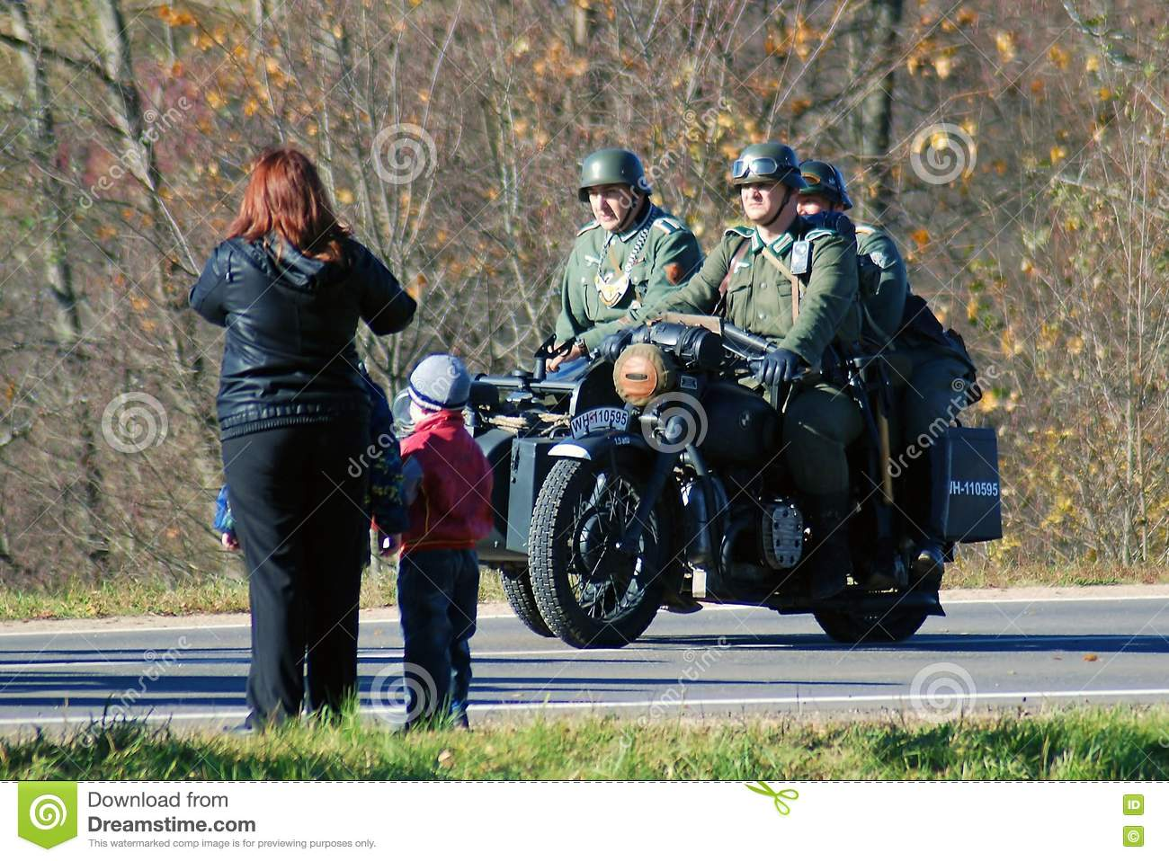 A woman and children look at three military men in retro uniform