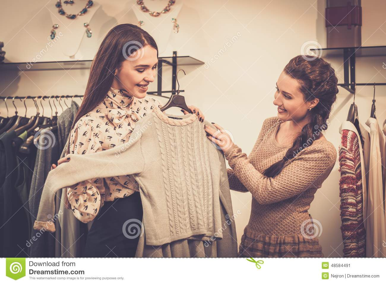 w choosing clothes shop assistant stock photo image w choosing clothes shop assistant