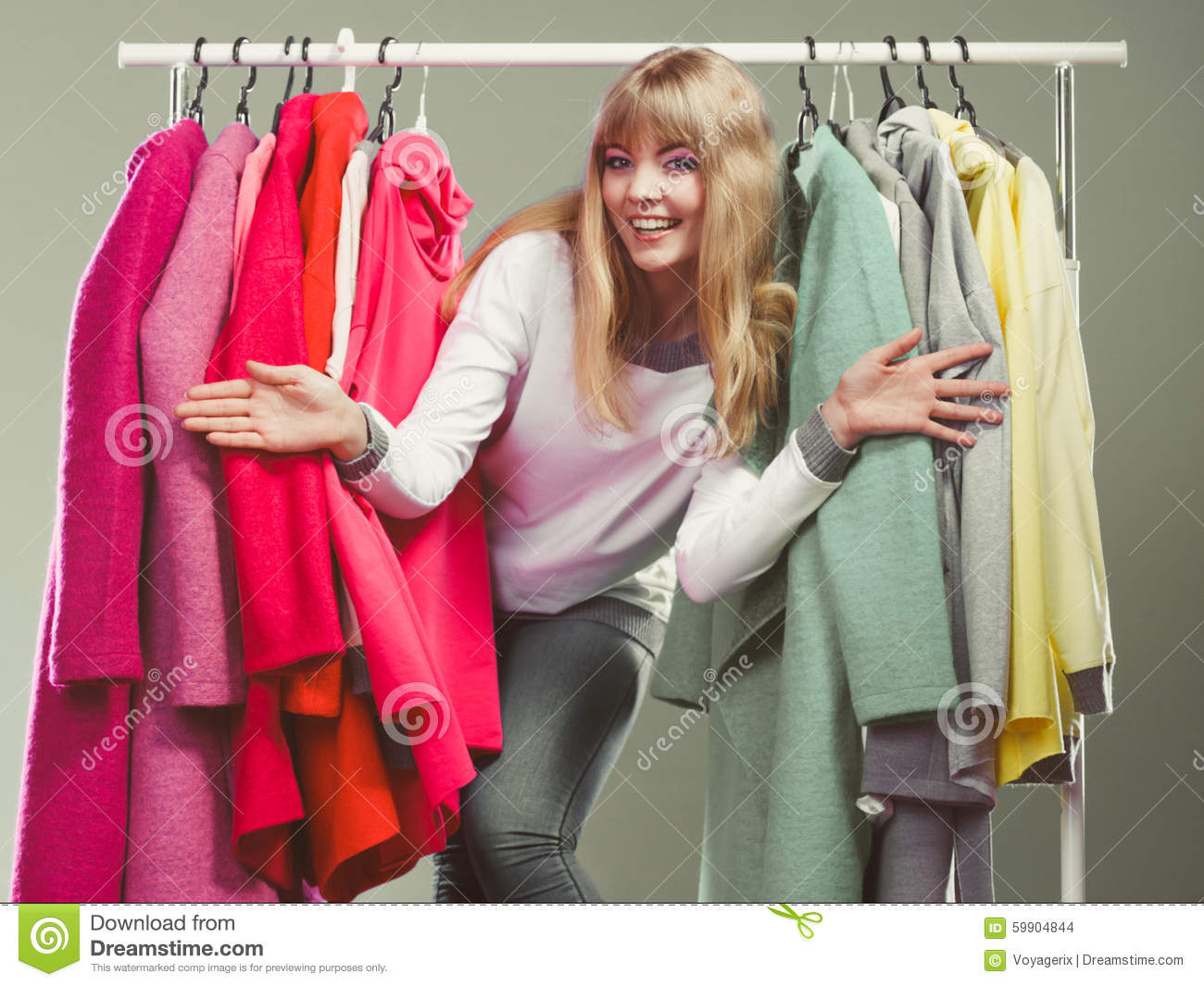 Woman Choosing Clothes To Wear In Mall Or Wardrobe Stock ...
