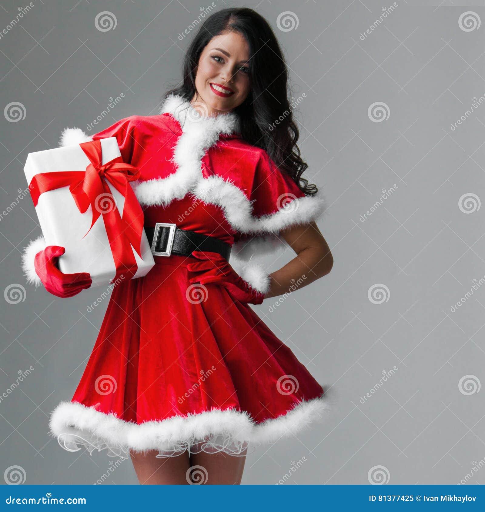 Woman with christmas gift stock image. Image of beauty - 81377425