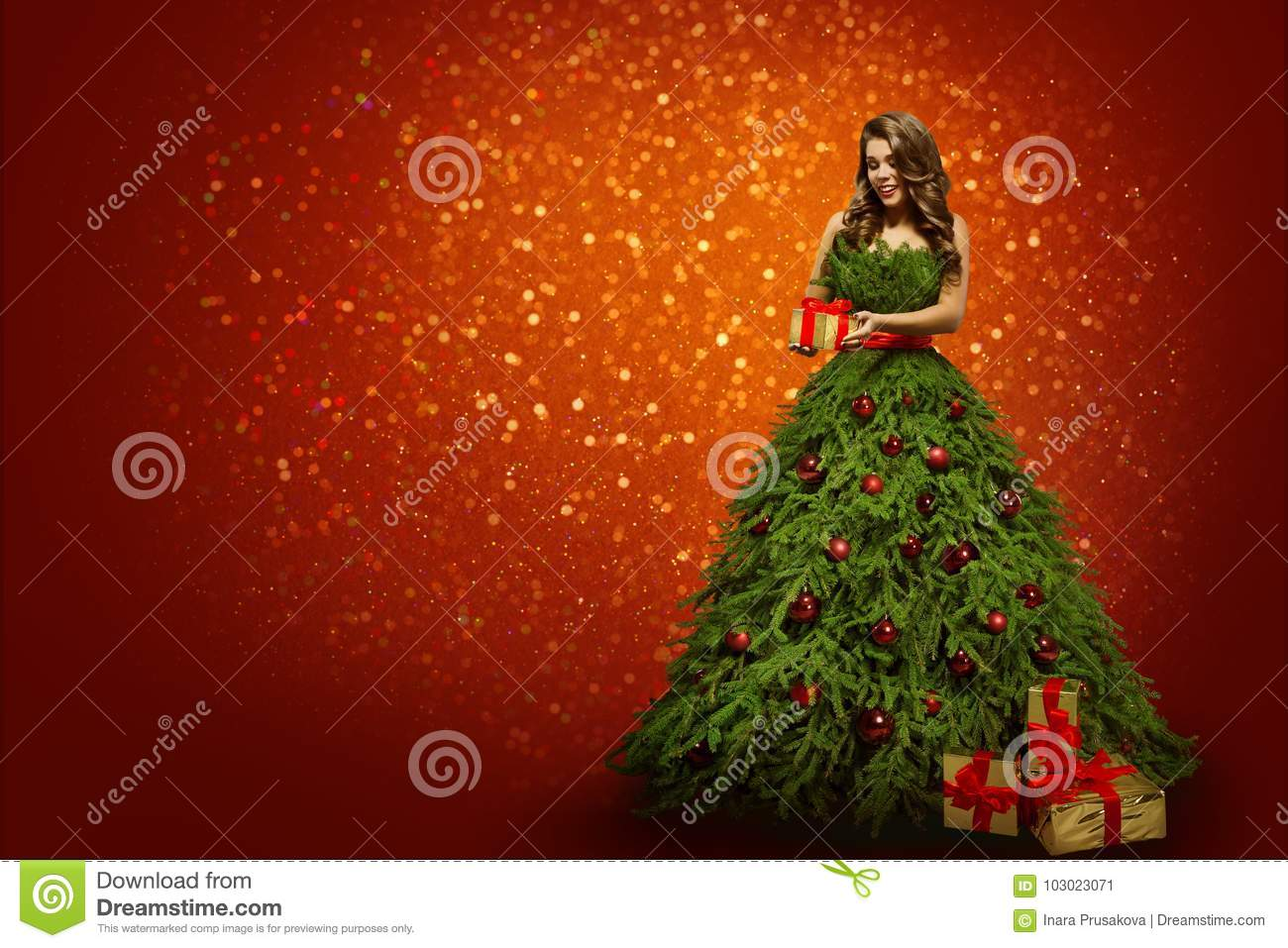 woman in christmas tree dress holding present gift fashion girl