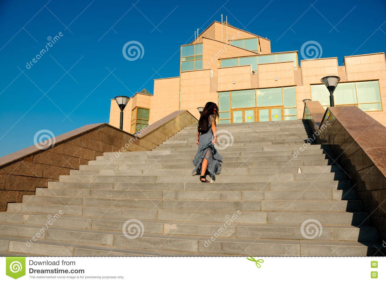 Woman On A City Street Climbs The Stairs Stock Image