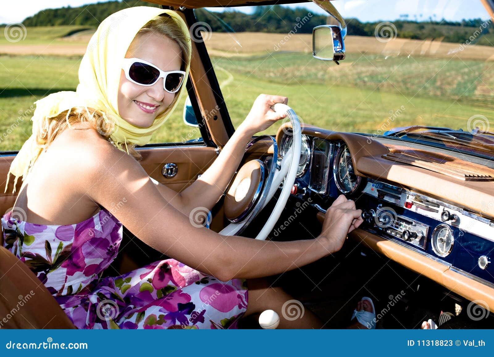 woman in vintage car
