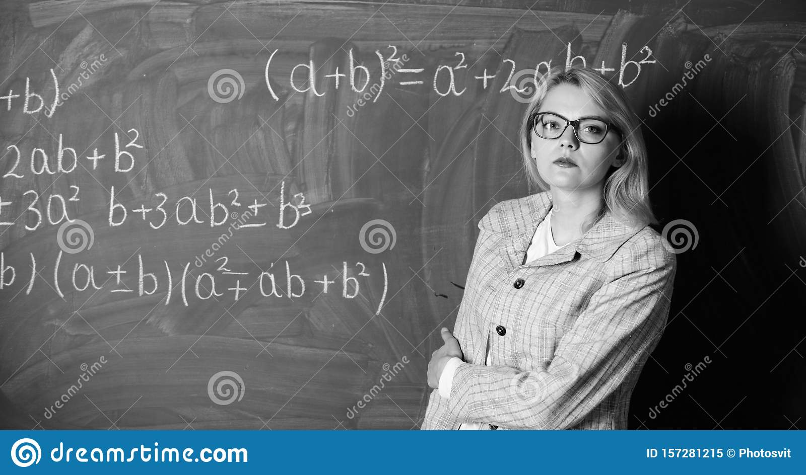 Woman in classroom. teacher on school lesson at blackboard. Back to school. Teachers day. Study and education. Modern