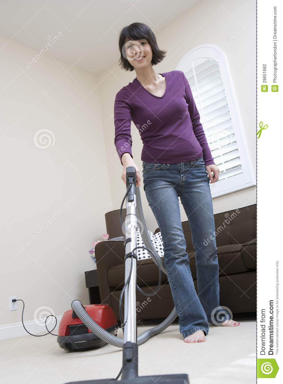 Woman Cleaning Floor At Home