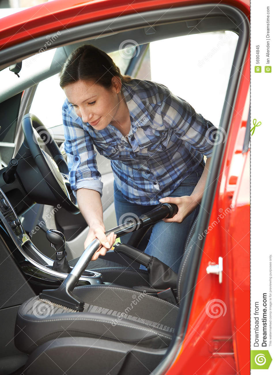 woman cleaning inside of car using vacuum cleaner stock photo image 56904845. Black Bedroom Furniture Sets. Home Design Ideas