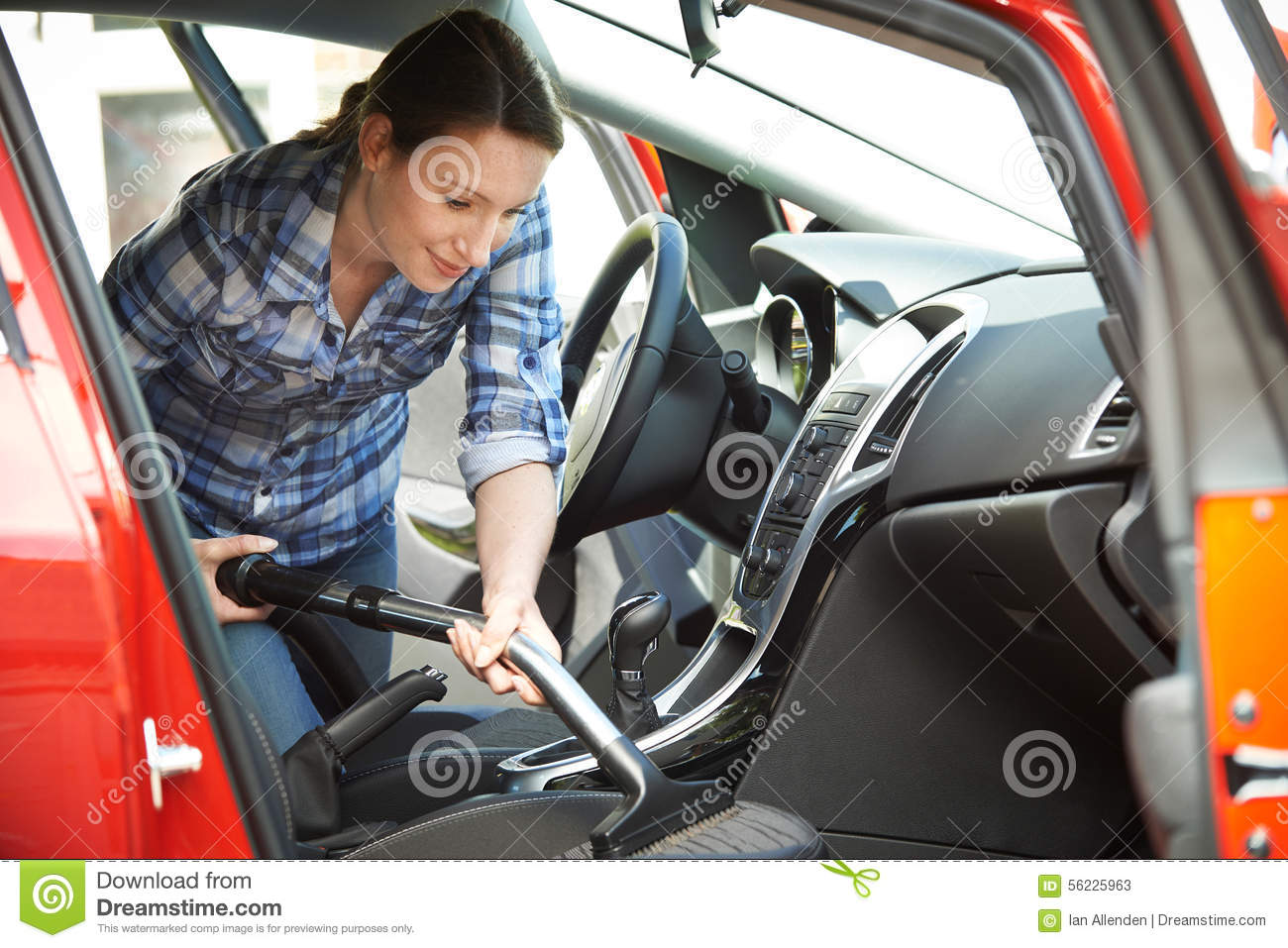woman cleaning interior of car using vacuum cleaner stock photo image 56225963. Black Bedroom Furniture Sets. Home Design Ideas