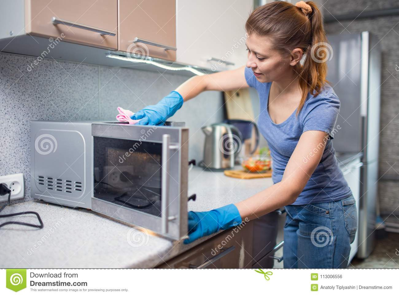 Woman cleaning in the kitchen