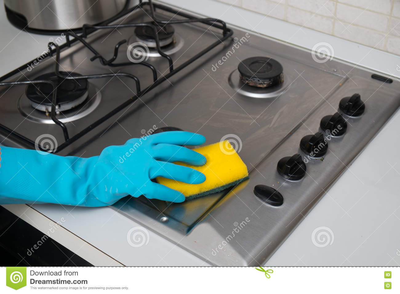 Woman Cleaning Stainless Steel Gas Surface In The Kitchen At Ho ...