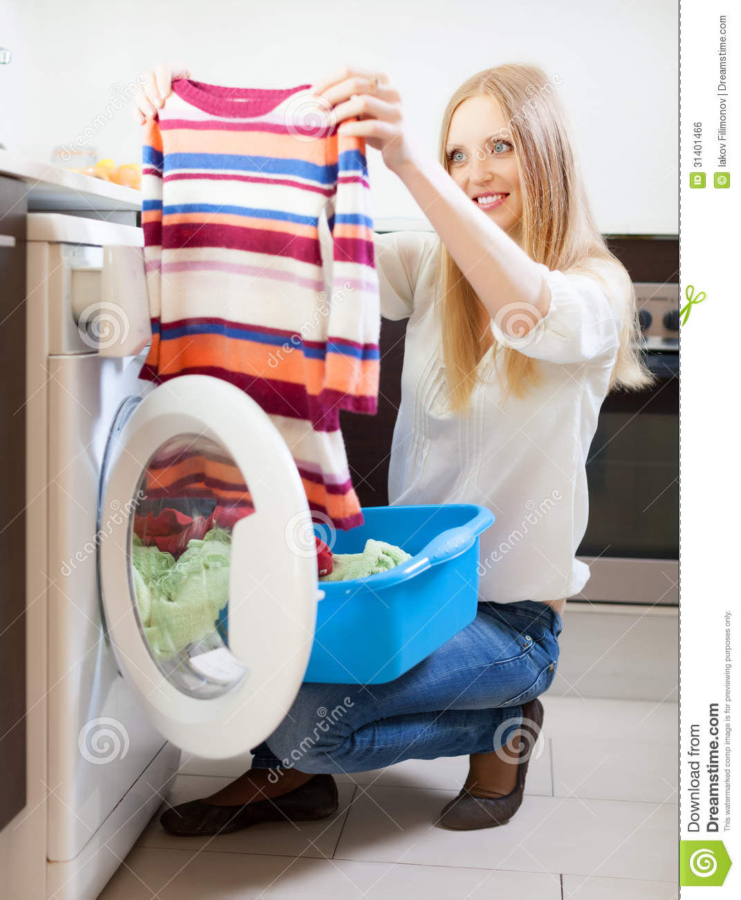 Woman with color clothes near washing machine stock photo image 31401466 - Protect clothes colors washing ...