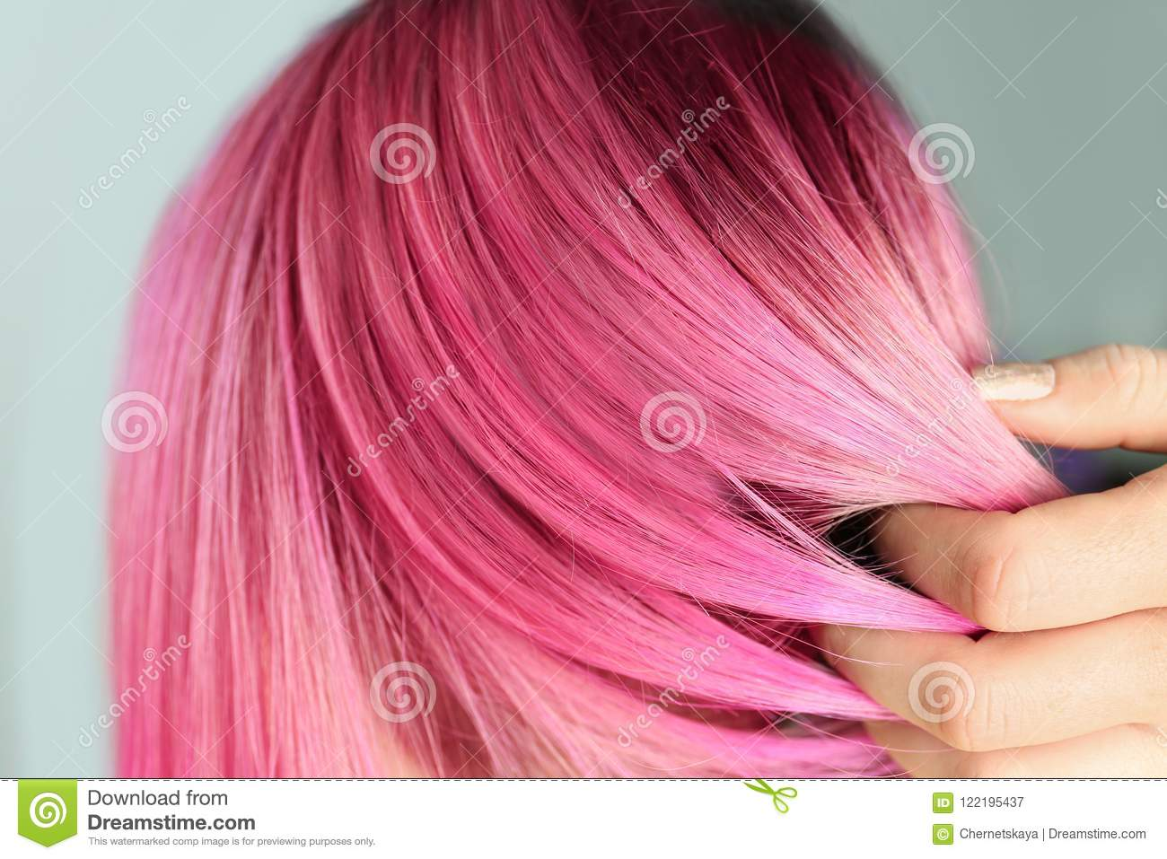 Woman with color dyed hair, close up view.