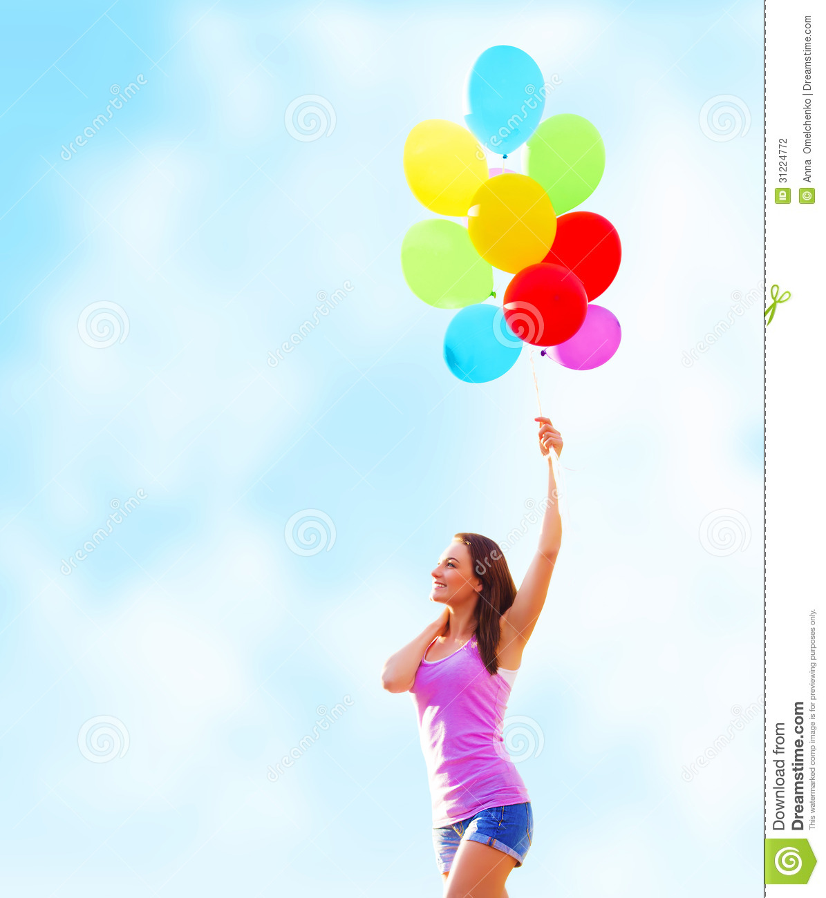 Beautiful young woman holding in hand many colorful balloons on blue ...