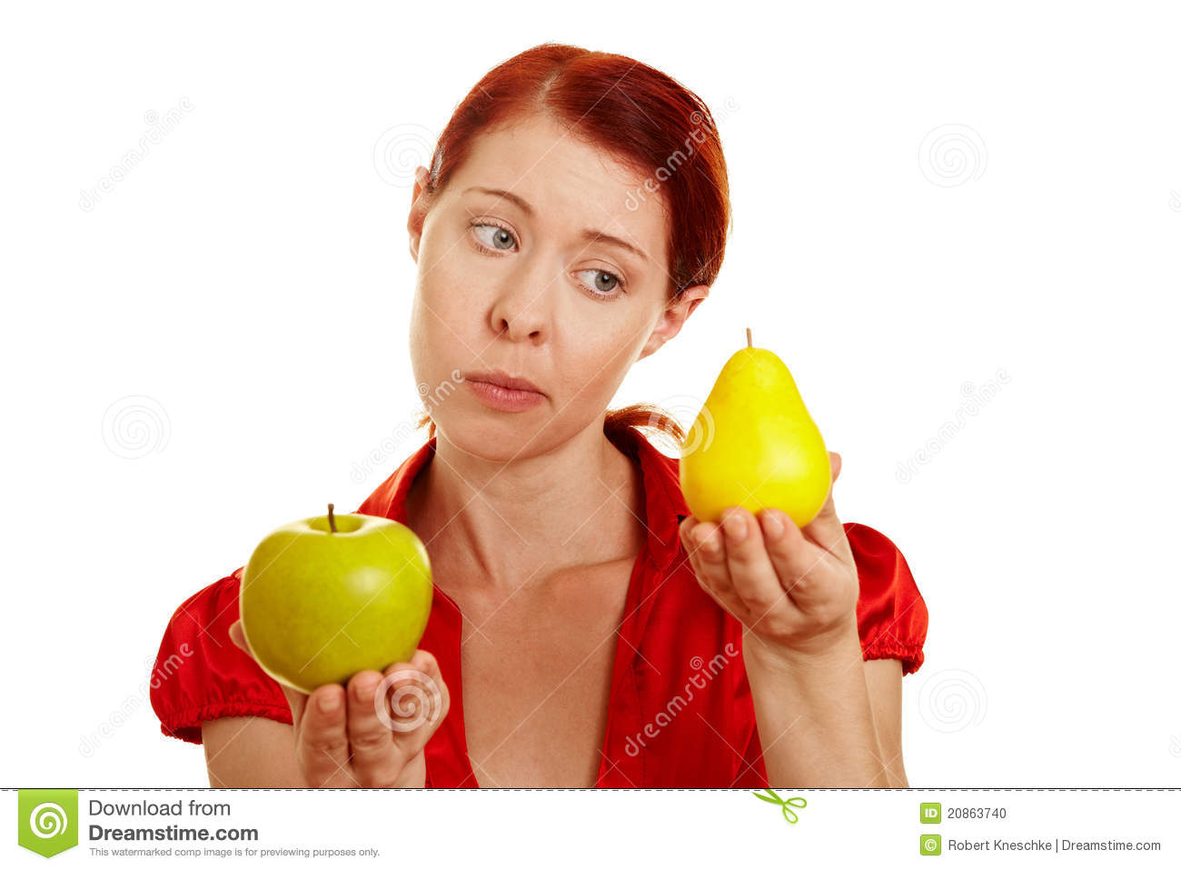 Woman Comparing Apple And Pear Stock Photo - Image: 20863740