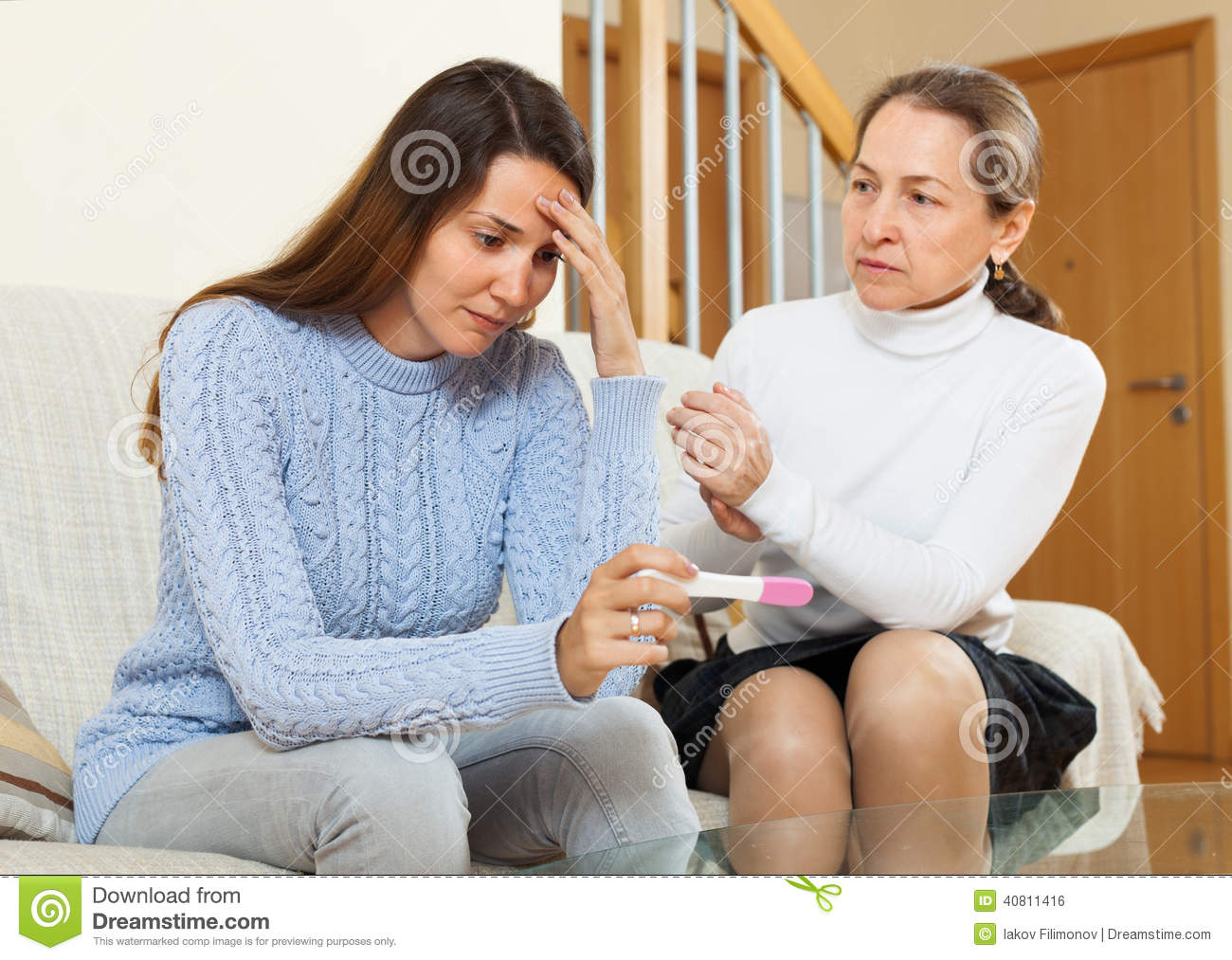 Woman Consoling The Worried Daughter Stock Photo