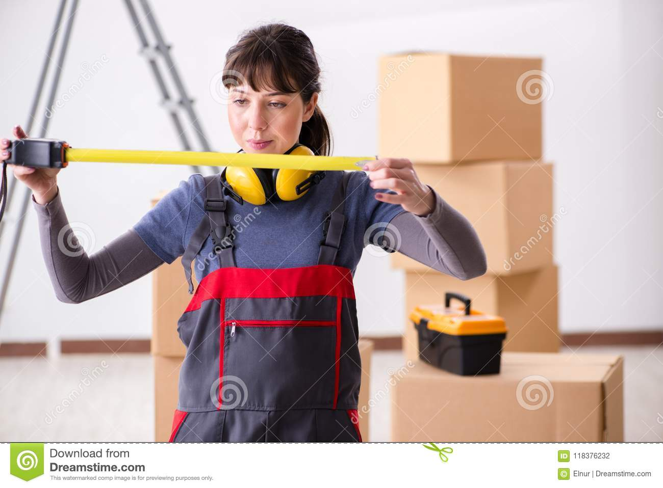 The woman contractor with measuring tape