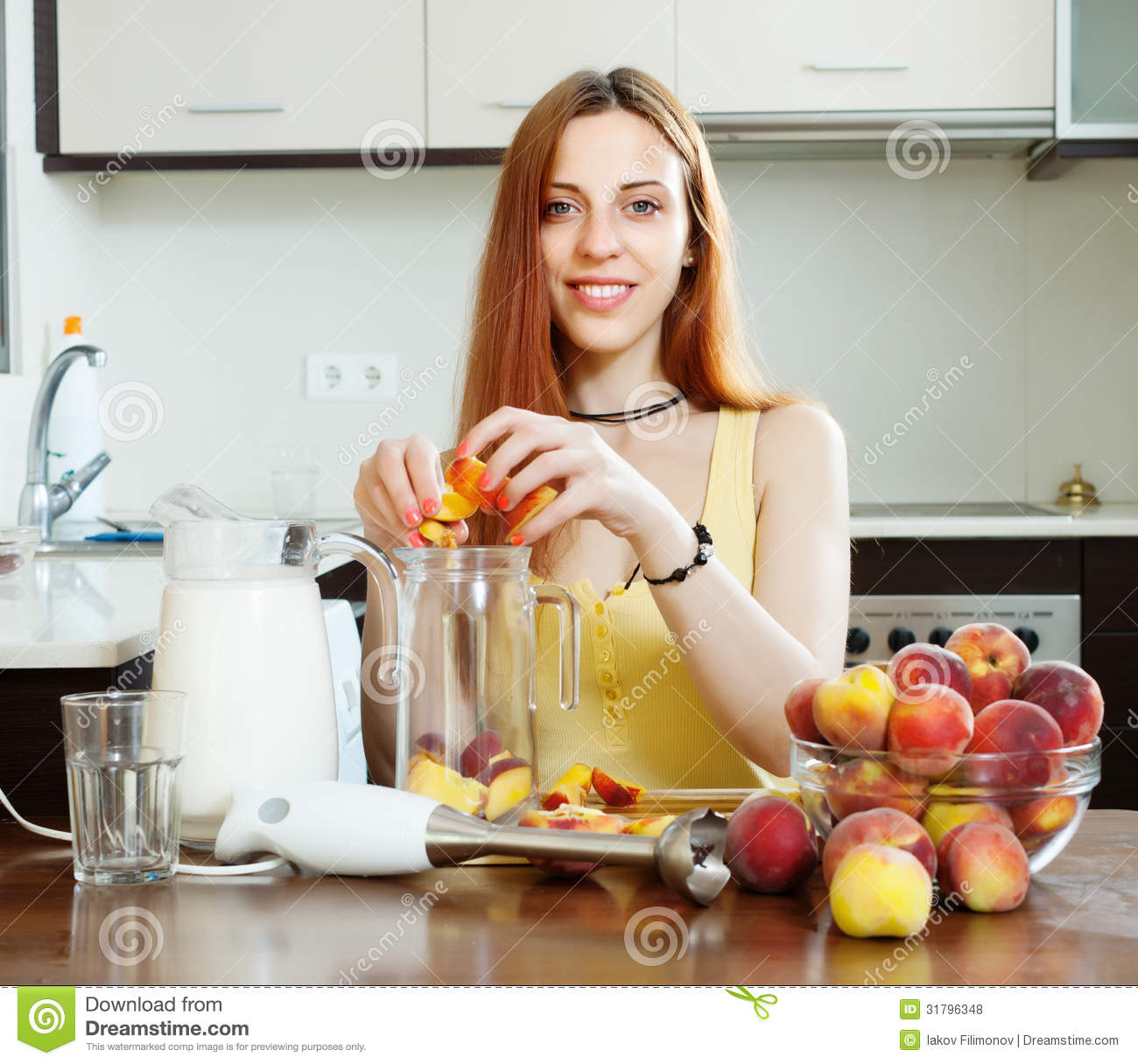 Women Kitchen: Woman Cooking Beverages With Blender From Peaches Stock