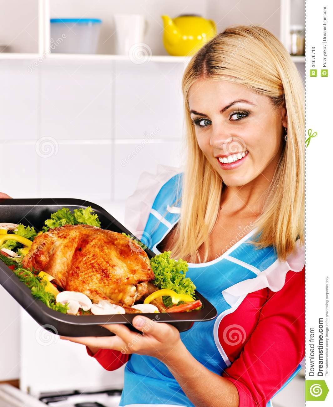 Woman Cooking Chicken At Kitchen. Stock Photos - Image: 34070713
