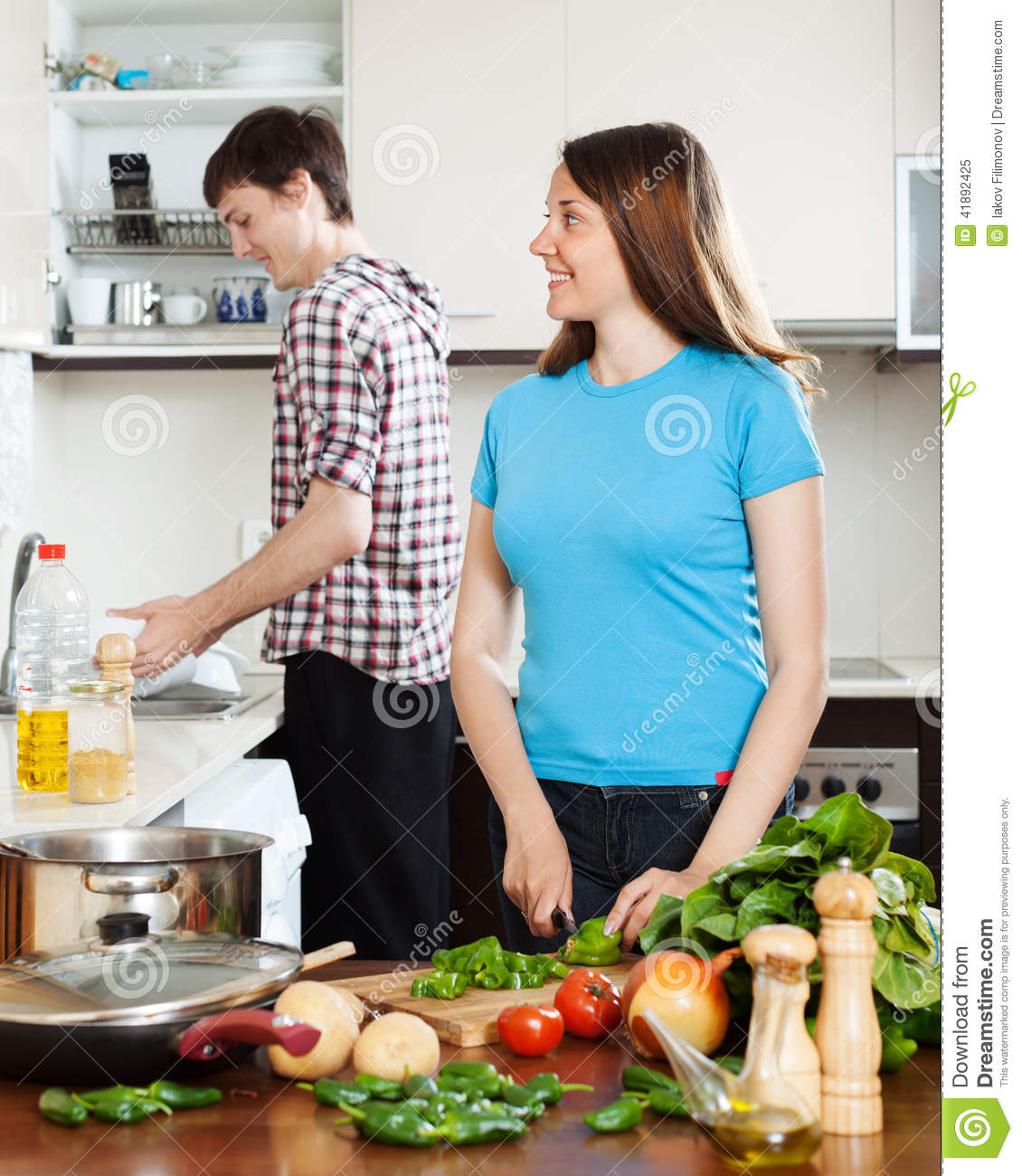 Woman cooking food while man washing dishes stock photo image 41892425 - Foods never wash cooking ...