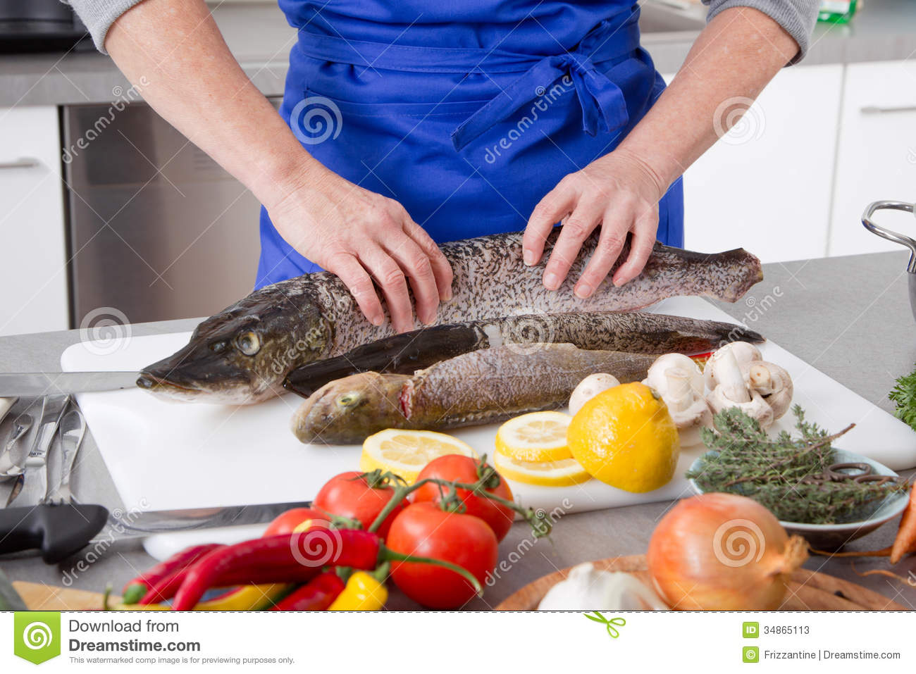 Woman is cooking fresh fish stock image image 34865113 for Cookery fish creek