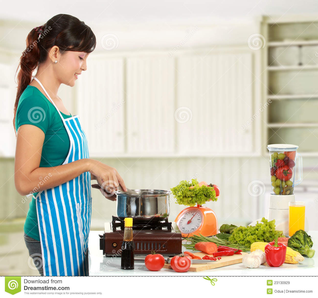Women Kitchen: Woman Cooking In The Kitchen Stock Image