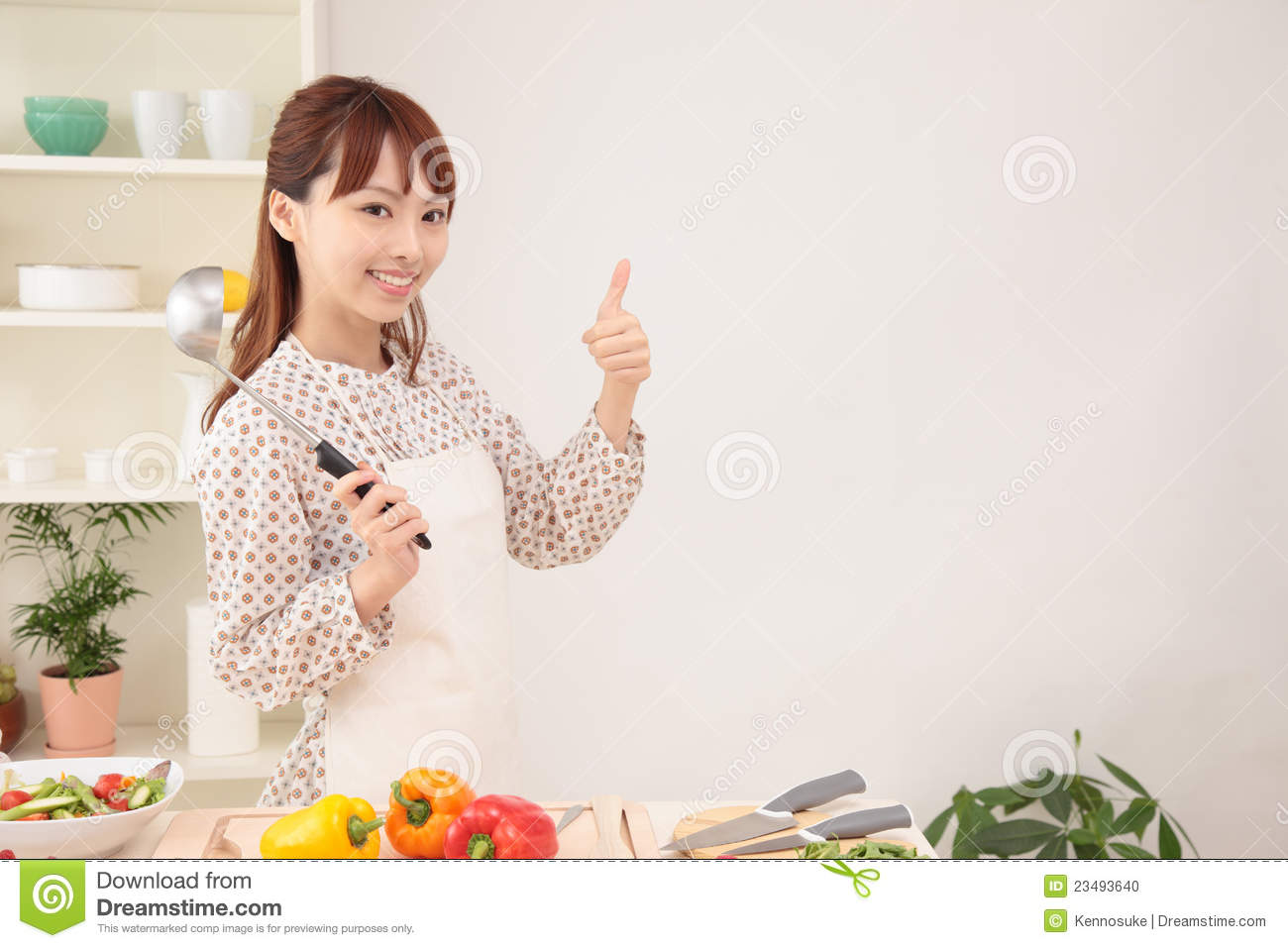 Woman cooking in kitchen with space for copy