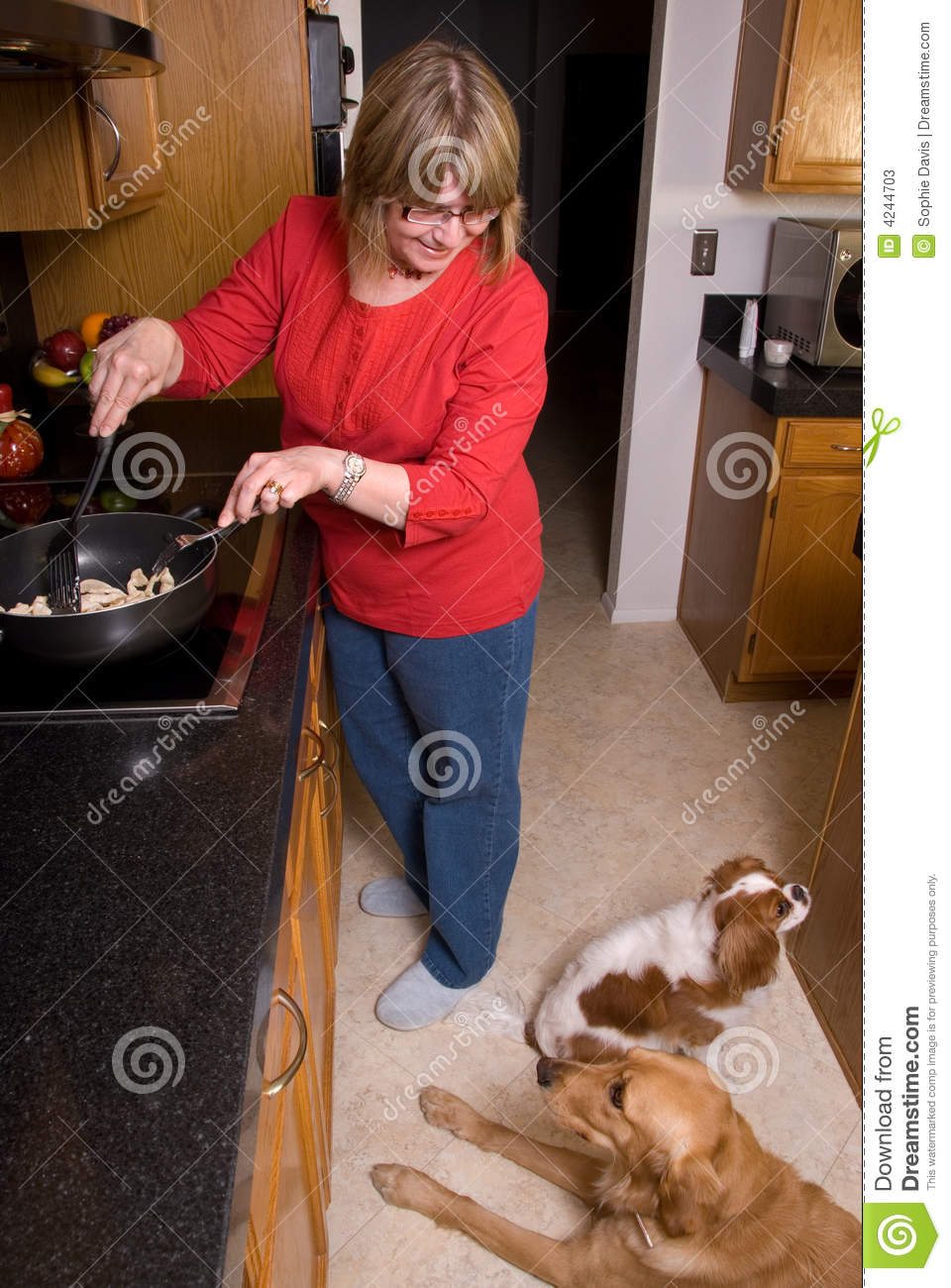 Woman cooking and smiling at h